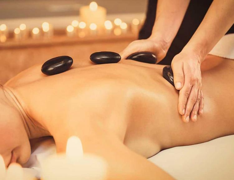Massage aux pierres chaudes à Rossens